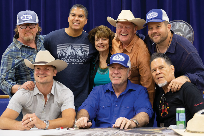 Matthew Gaston | The Sheridan Press<br>Cast members of the hit television shoe, Longmire, pose for a photo with Longmire creator Craig Johnson before an autograph signing at the Bomber Mountain Civc Center Friday, July 19, 2019. Back row from left, John Bishop, Jeffrey De Sarrano, Louanne Stephens, creator Craig Johnson and Adam Bartley. Front row from left, Bailey Chase, Robert Taylor and Adolph Martinez.