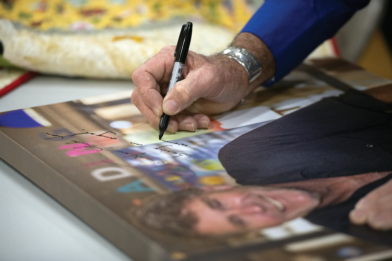 Matthew Gaston | The Sheridan Press<br>Actor Robert Taylor a.k.a. Sheriff Walt Longmire autographs a large canvas for a fan durings Longmire days in Buffalo Friday, July 19, 2019.