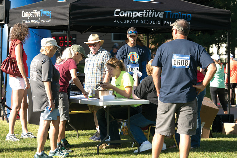 Matthew Gaston | The Sheridan Press<br>From left, John Manzella, Michelle Morian and Denise Arnaud register people for the Longmire Days 5k/1 mile walk at Prosinski Park in Buffalo Friday, July 19, 2019.