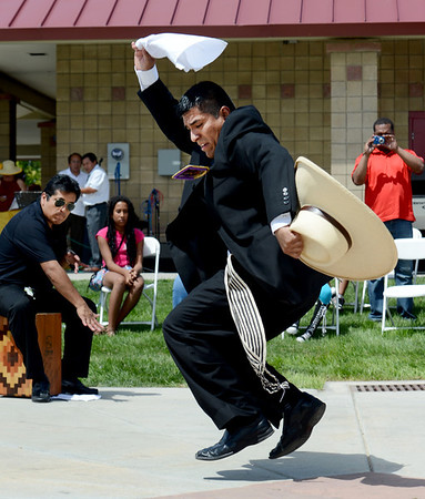 "Moises Torrez performs a traditional Peruvian dance during the festival on Sunday.<br /> Hundreds of people gathered at Sandstone Ranch in Longmont on Sunday to celebrate the culture of Peru.<br /> For more photos and a video, go to  <a href=""http://www.timescall.com"">http://www.timescall.com</a> or  <a href=""http://www.dailycamera.com"">http://www.dailycamera.com</a>.<br /> Cliff Grassmick  / July 29, 2012"