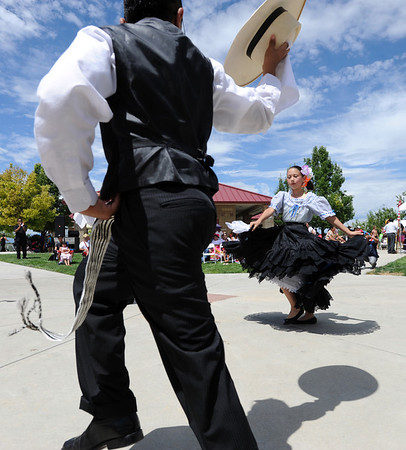 "Angel Lopez, left, and Jacqueline Magallanez, dance a traditional Peruvian dance during the festival on Sunday.<br /> Hundreds of people gathered at Sandstone Ranch in Longmont on Sunday to celebrate the culture of Peru.<br /> For more photos and a video, go to  <a href=""http://www.timescall.com"">http://www.timescall.com</a> or  <a href=""http://www.dailycamera.com"">http://www.dailycamera.com</a>.<br /> Cliff Grassmick  / July 29, 2012"