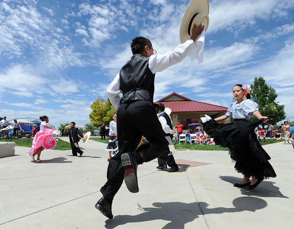 "Angel Lopez, center, and Jacqueline Magallanez, dance a traditional Peruvian dance during the festival on Sunday.<br /> Hundreds of people gathered at Sandstone Ranch in Longmont on Sunday to celebrate the culture of Peru.<br /> For more photos and a video, go to  <a href=""http://www.timescall.com"">http://www.timescall.com</a> or  <a href=""http://www.dailycamera.com"">http://www.dailycamera.com</a>.<br /> Cliff Grassmick  / July 29, 2012"