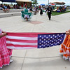 "Mia Neah-Murphy, left, and Camila Lopez hold the US Flag while others dance in the background.<br /> Hundreds of people gathered at Sandstone Ranch in Longmont on Sunday to celebrate the culture of Peru.<br /> For more photos and a video, go to  <a href=""http://www.timescall.com"">http://www.timescall.com</a> or  <a href=""http://www.dailycamera.com"">http://www.dailycamera.com</a>.<br /> Cliff Grassmick  / July 29, 2012"