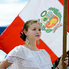 "Vanessa Lang holds the flag of Peru during a ceremony at the festival on Sunday.<br /> Hundreds of people gathered at Sandstone Ranch in Longmont on Sunday to celebrate the culture of Peru.<br /> For more photos and a video, go to  <a href=""http://www.timescall.com"">http://www.timescall.com</a> or  <a href=""http://www.dailycamera.com"">http://www.dailycamera.com</a>.<br /> Cliff Grassmick  / July 29, 2012"