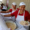 "Eloise Lozano, left, and her mother, Adela Lozano, serve Peruvian food during the festival on Sunday.<br /> Hundreds of people gathered at Sandstone Ranch in Longmont on Sunday to celebrate the culture of Peru.<br /> For more photos and a video, go to  <a href=""http://www.timescall.com"">http://www.timescall.com</a> or  <a href=""http://www.dailycamera.com"">http://www.dailycamera.com</a>.<br /> Cliff Grassmick  / July 29, 2012"