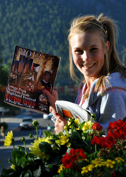 A high school student in Estes Park, selling program guides for the Annual Longs Peak Scottish-Irish Highland Festival, in order to raise funds for extracurricular activities at school.