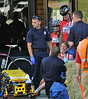 A competitor in the Women's 3 4 Div from NEBC Racing of Burlington, Mass is tended to by Fitchburg Fire Dept EMTs after being involved in a multi bike crash at the corner of Putnam  St and Boulder Dr. SENTNIEL & ENTERPRISE/JIM MARABELLO