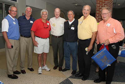"""Marist football alum including (l-r) Frank McCloskey (guard, class of '68), Joe Neiner (tight end/defensive end, class of '68), Richard Difore (split end/defensive end, class of '68), Clarence Smith (tight end/defensive end, class of '68), Larry Sertich (fullback/safety, class of '68), Jim """"Butch"""" Murphy (lineman, class of '66), and Lou Lombardy (fullback, class of '65) return to the school for the special celebration and game marking the 100th anniversary of the Marist football program."""
