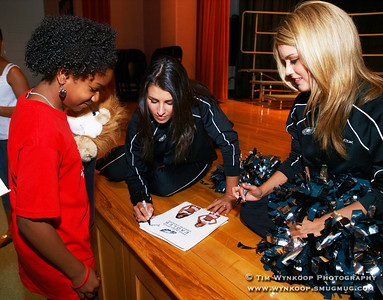 Lopatcong Township, NJ, 6/4/2008: Lopatcong Township Middle School 5th grader, Yulanda Spencer, gets autographs from Philadelphia Eagles cheerleaders, Alaina Caldwell, left, of Berlin, NJ and Janelle Stangl, right, of Bethlehem, Pa.,. The cheerleaders were special guests at the Lopatcong Township Middle School D.A.R.E. Graduation ceremony Wednesday night at the school. (Photo by: Tim Wynkoop)