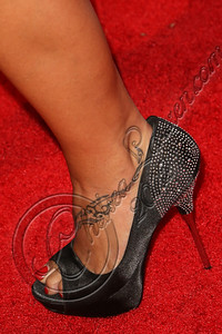 HOLLYWOOD, CA - OCTOBER 08:  Actress Q'orianka Kilcher (shoe detail) arrives at Los Angeles Confidential Magazine Celebrates Their Men's Issue Cover Party with Dennis Quaid at The Residences At W Hollywood on October 8, 2012 in Hollywood, California.  (Photo by Chelsea Lauren/WireImage)