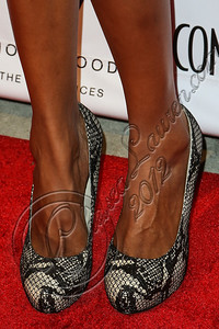 HOLLYWOOD, CA - OCTOBER 08:  Actress Judi Shekoni (shoe detail) arrives at Los Angeles Confidential Magazine Celebrates Their Men's Issue Cover Party with Dennis Quaid at The Residences At W Hollywood on October 8, 2012 in Hollywood, California.  (Photo by Chelsea Lauren/WireImage)