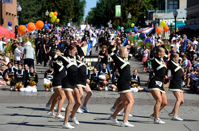 The Monarch High School Pom Squad performs in front of the judges during the Louisville Labor Day Parade in Louisville, Colorado September 5, 2011.   CAMERA/Mark Leffingwell