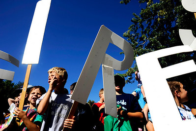 (From left to right) Fireside Elementary students Trevor Horn, 6, Connor, Horn, and Hayden Bolles, 7, carry their signs as they march with other students in the Louisville Labor Day Parade in downtown Louisville, Monday, Sept. 7, 2009. The annual event hosted a pie baking contest, food and craft booths, and live music. DAILY CAMERA/Kasia Broussalian For more photos and a video of the event, please visit www.dailycamera.com