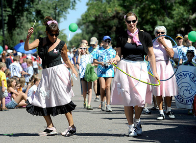 Sharry Helpin (left) and Ceryl Davis dance to 50's tunes during the Louisville Labor Day Parade in Louisville, Colorado September 5, 2011.   CAMERA/Mark Leffingwell