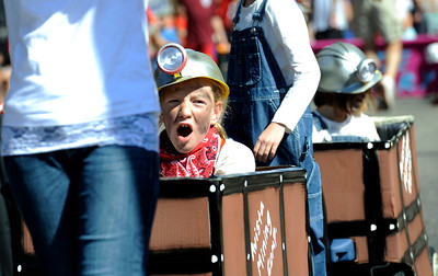 Emma Wagner, 10, cheers while riding in a mine car during the Louisville Labor Day Parade in Louisville, Colorado September 5, 2011.   CAMERA/Mark Leffingwell