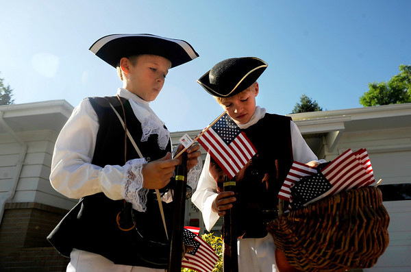 "Children of the Revolution Reed Coker, 10, (left) and Jack Carlson, 7, ready their flags before the start of the Louisville Labor Day Parade in downtown Louisville, Monday, Sept. 7, 2009. The annual event hosted a pie baking contest, food and craft booths, and live music.<br /> DAILY CAMERA/Kasia Broussalian<br /> For more photos and a video of the event, please visit  <a href=""http://www.dailycamera.com"">http://www.dailycamera.com</a>"