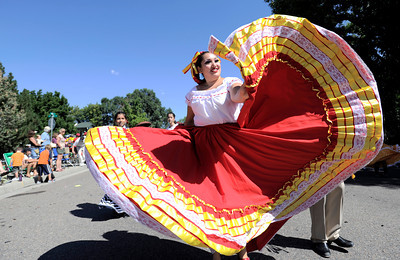 Leticia Arroyo, with Grupo Folklorico Sabor De Mexico flairs out her dress while dancing in the Louisville Labor Day Parade in Louisville, Colorado September 5, 2011.   CAMERA/Mark Leffingwell