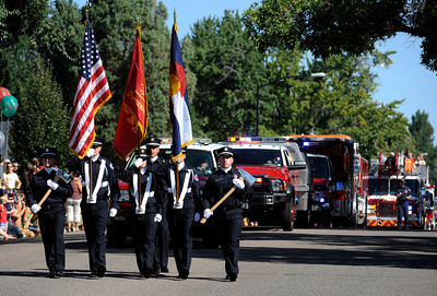 Fire Fighters lead off the the Louisville Labor Day Parade in Louisville, Colorado September 5, 2011.   CAMERA/Mark Leffingwell