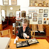 "Bridget Bacon, Louisville Historical Museum Coordinator, looks through historical photos at the museum.<br /> The Louisville Historical Museum celebrates 25-years in existence.<br /> For  more photos and a video of the museum, go to  <a href=""http://www.dailycamera.com"">http://www.dailycamera.com</a>.<br /> Cliff Grassmick / September 22, 2011"