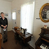 "Bridget Bacon, Louisville Historical Museum Coordinator, stands in the living room of the miner's cottage.<br /> The Louisville Historical Museum celebrates 25-years in existence.<br /> For  more photos and a video of the museum, go to  <a href=""http://www.dailycamera.com"">http://www.dailycamera.com</a>.<br /> Cliff Grassmick / September 22, 2011"