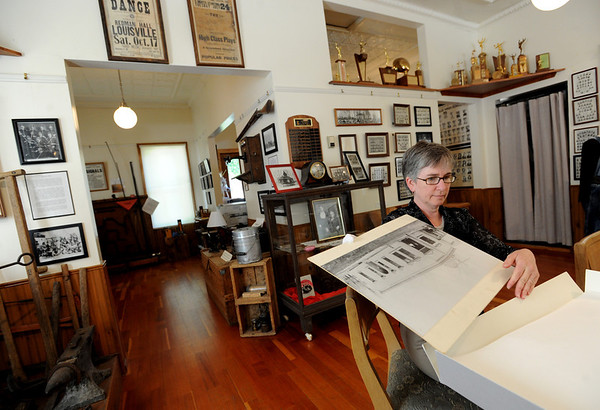"""Bridget Bacon, Louisville Historical Museum Coordinator, looks through historical photos at the museum.<br /> The Louisville Historical Museum celebrates 25-years in existence.<br /> For  more photos and a video of the museum, go to  <a href=""""http://www.dailycamera.com"""">http://www.dailycamera.com</a>.<br /> Cliff Grassmick / September 22, 2011"""