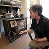 "Bridget Bacon, Louisville Historical Museum Coordinator, explains how the coal stove works.<br /> The Louisville Historical Museum celebrates 25-years in existence.<br /> For  more photos and a video of the museum, go to  <a href=""http://www.dailycamera.com"">http://www.dailycamera.com</a>.<br /> Cliff Grassmick / September 22, 2011"