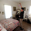 "Bridget Bacon, Louisville Historical Museum Coordinator, turns on the light in the bedroom of the miner's cottage.<br /> The Louisville Historical Museum celebrates 25-years in existence.<br /> For  more photos and a video of the museum, go to  <a href=""http://www.dailycamera.com"">http://www.dailycamera.com</a>.<br /> Cliff Grassmick / September 22, 2011"