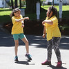 32nd annual Acre Cleanup run by CBA at North Common. Juliana Irizarry of Nashua, left, and Johanna E. Cortes of Lowell, right. (SUN/Julia Malakie)
