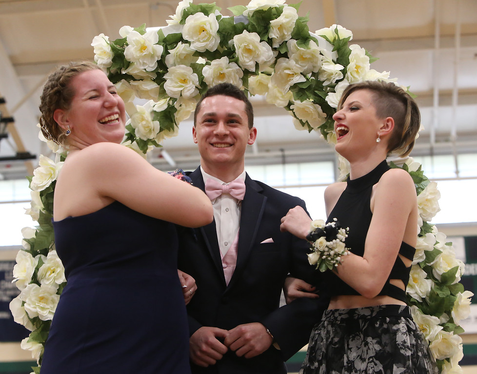 . Lowell Catholic\'s pre-prom promenade. From left, Mikayla Patterson of Pelham, Zachary Finnegan of Pelham, who goes to Pelham High School, and Faith Dame. (SUN/Julia Malakie)