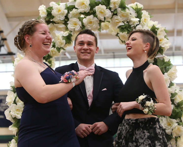 Lowell Catholic's pre-prom promenade. From left, Mikayla Patterson of Pelham, Zachary Finnegan of Pelham, who goes to Pelham High School, and Faith Dame (spelling?, didn't get town). (SUN/Julia Malakie)
