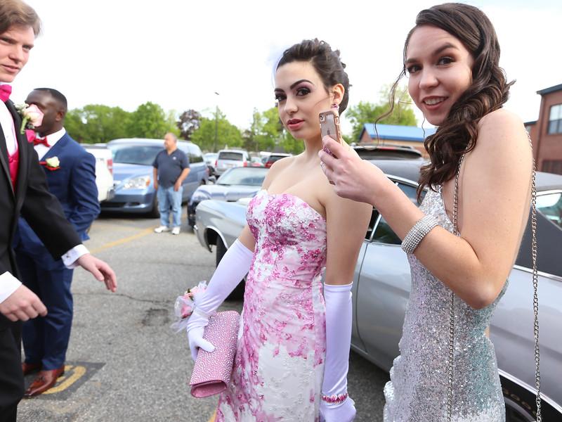 Lowell Catholic's pre-prom promenade. Vanessa Carlson of Methuen, left, and Kendra McFadyen of Tewksbury. (SUN/Julia Malakie)