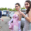 Lowell Catholic's pre-prom promenade. Vanessa Carlson of Methuen, left, and Kendra McFadyen of Tewksbury. (SUN/Julia Malakie)