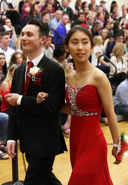 . Lowell Catholic\'s pre-prom promenade. Mark Little of Dracut and Lynn Kobayashi of Chelmsford. (SUN/Julia Malakie)