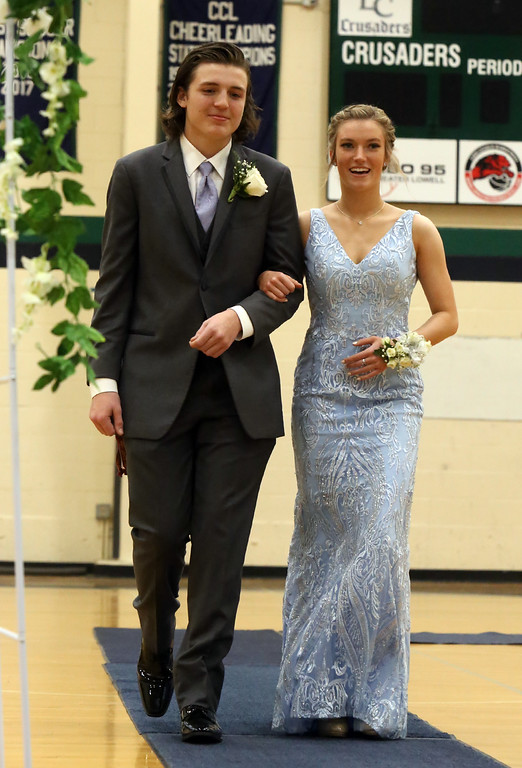 . Lowell Catholic pre-prom procession at the gym. (SUN/Julia Malakie)