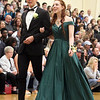 Lowell Catholic pre-prom procession at the gym. Olivia Hebert and Max Stever, both of Lowell. (SUN/Julia Malakie)