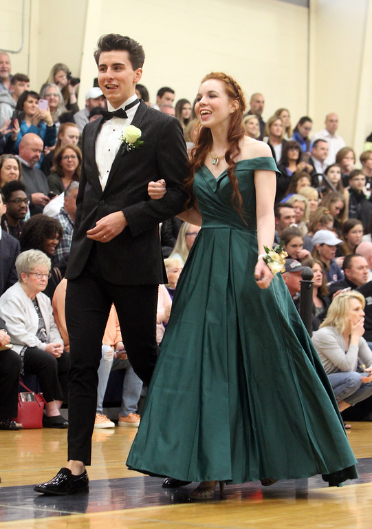 . Lowell Catholic pre-prom procession at the gym. Olivia Hebert and Max Stever, both of Lowell. (SUN/Julia Malakie)