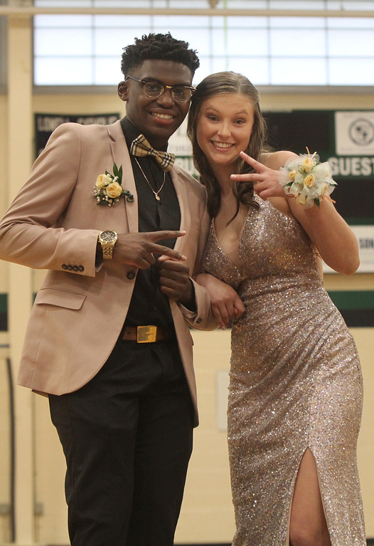 . Lowell Catholic pre-prom procession at the gym. Deon Chidarikire and Ali Dresser, both of Lowell. (SUN/Julia Malakie)