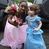 Lowell Catholic pre-prom procession at the gym. Patricia Adesanya of Lowell with Addison Feeney, 3, of Lowell, daughter of Adesanya's soccer, track and lacrosse coach. (SUN/Julia Malakie)