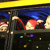 Lowell City of Lights Parade 2019. From left, Melanie Sanchez of Lowell, Janciel Delaney, 3, throwing out candy, and his mother Tela Delaney of Lowell, on the Community Teamwork Inc. bus. (SUN/Julia Malakie)