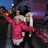 Lowell City of Lights Parade 2019. Emma Skillman, 7, front her sister Ava Skillman, 8, and their mother Amy Linscott of Lowell, cheer the approaching parade. (SUN/Julia Malakie)