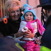 Lowell City of Lights Parade 2019. Joanne Talty of Methuen, with her granddaughter Nora Talty, 2, of Charlestown. (SUN/Julia Malakie)
