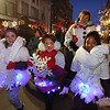 Lowell City of Lights Parade 2019. From left, Brownie Troop 85243 members Aaliyah Boisvert,Karli Polito and Vera Mondelus, all 7, and from Lowell, with Boisvert's mother and troop leader Jen Boisvert. (SUN/Julia Malakie)