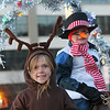 Lowell City of Lights Parade 2019. Katie Monaco, 8, of Littleton, and Matthew Hosington, 4-1/2, of Harvard, on the Littleton Hack 'n' Tack float, at the staging area. (SUN/Julia Malakie)