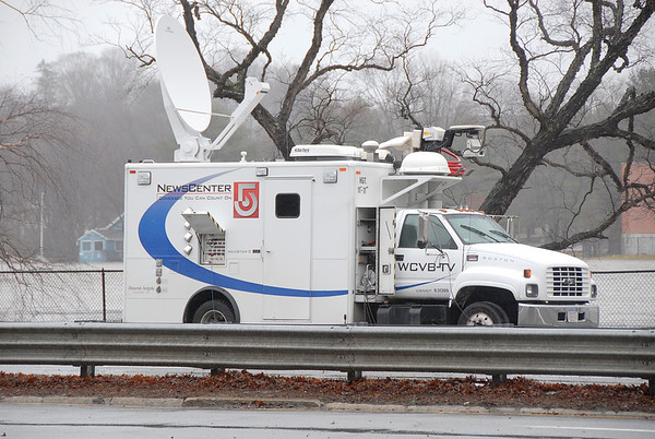 The Boston TV stations are in town. Merrimack River, Lowell, MA