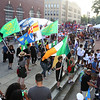First night of Lowell Folk Festival. Parade to Boarding House Park and opening ceremony. Irish flags in parade to Boarding House Park.  (SUN/Julia Malakie)