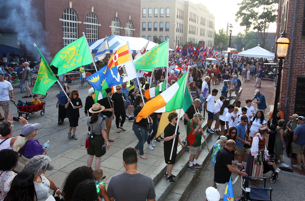 . First night of Lowell Folk Festival. Parade to Boarding House Park and opening ceremony. Irish flags in parade to Boarding House Park.  (SUN/Julia Malakie)