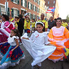First night of Lowell Folk Festival. Parade to Boarding House Park and opening ceremony. From left front, Analia Naranjo, 6, her sister Ariana Naranjo, 10, and their mother Alisson Naranjo of Lowell, in parade with Colombian group.  (SUN/Julia Malakie)