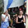 First night of Lowell Folk Festival. Parade to Boarding House Park and opening ceremony. Jennifer Banks of Littleton, left, and her friend Pamela Kopsiaftis of Lowell watch opening parade at Boarding House Park. (SUN/Julia Malakie)