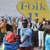 First night of Lowell Folk Festival. Parade to Boarding House Park and opening ceremony.  (SUN/Julia Malakie)