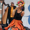 Saturday at Lowell Folk Festival. Ana Veydo sings as Grupo Cimarron perform Colombian joropo music. (SUN/Julia Malakie)